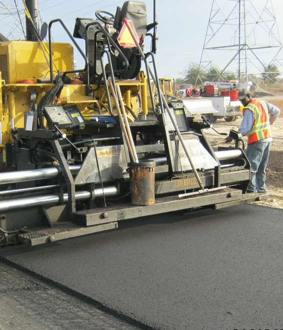 photo of road crews leveling asphalt
